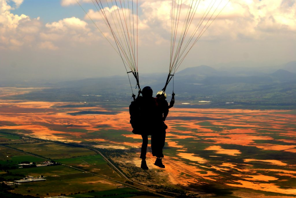 silhouette-of-person-on-parachute-during-sunset-3702806